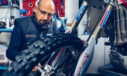 Paolo Drocco, co-owner of Innteck, mounting the front wheel on an off-road motorcycle.