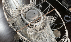 The chandelier over the stage comprises 40,000 hanging beads.