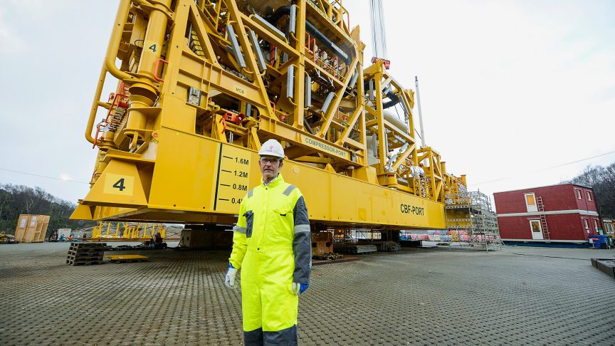 Torstein Vinterstø, Statoil's project director, in front of a compressor.